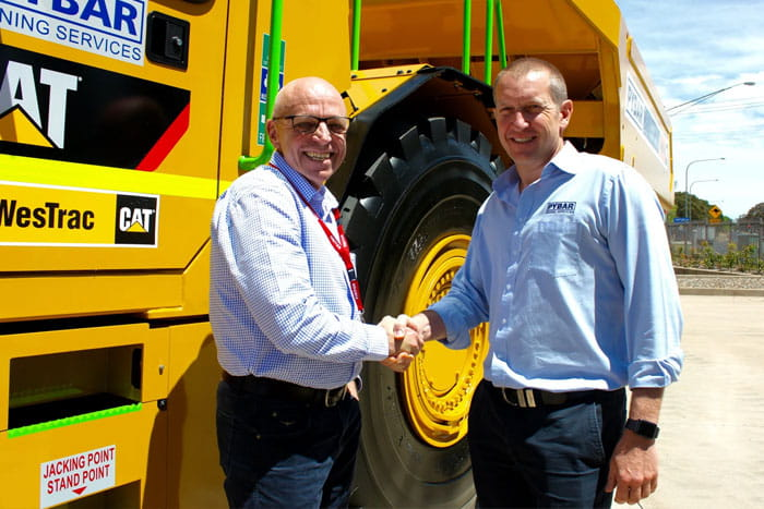Greg Graham presents the articulated truck to Pybar